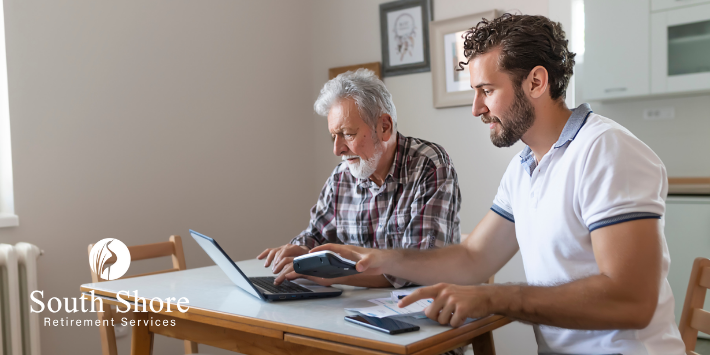 Retired man and son review financial plan